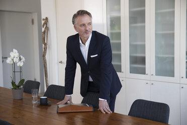Businessman in board room - SUF00394