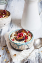 Porridge with cinnamon, millet, backed plum, pomegranate and roasted almond slivers - SBDF03409