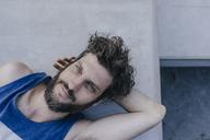 Portrait of relaxed man lying in skatepark - KNSF03178