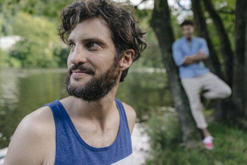 Portrait of man at the water looking sideways - KNSF03211