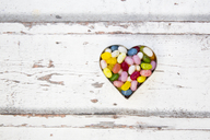 Jelly beans, heart shape on wood - LVF06493