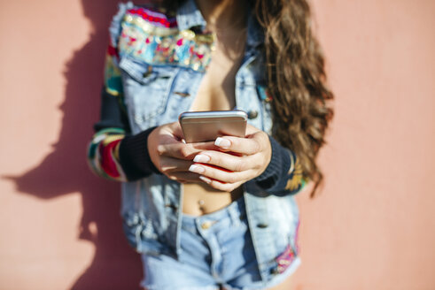 Woman's hands holding smartphone - KIJF01764