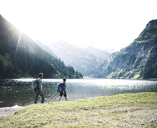 Austria, Tyrol, young couple hiking at mountain lake - UUF12468