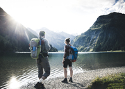 Austria, Tyrol, young couple hiking at mountain lake - UUF12471