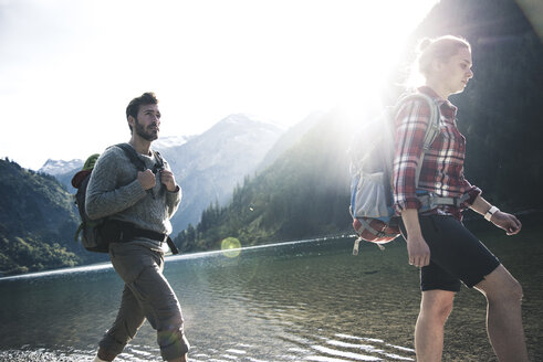 Austria, Tyrol, young couple hiking at mountain lake - UUF12474