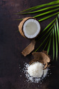Opened coconut, coconut husk and pile of coconut flakes - CSF28600
