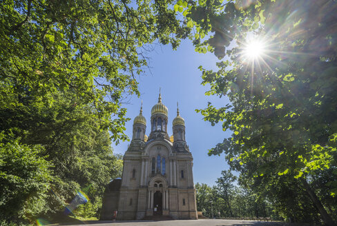 Germany, Hesse, Wiesbaden, Russian Orthodox Church against the sun - PVCF01212