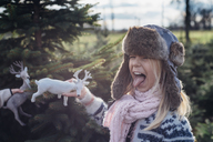 Little girl holding toy reindeer - MJF02210