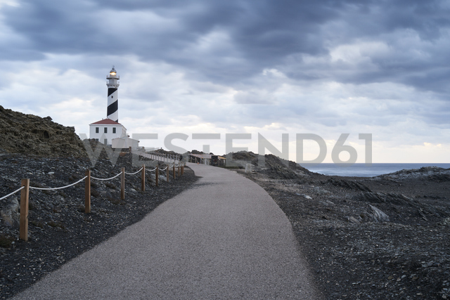 Spain, Balearic Islands, Menorca, Favaritx lighthouse surrounded by clouds in the morning - IGGF00269