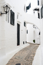 Spain, Menorca, Binibequer Vell, white traditional small village, alley - IGGF00275