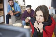 Worried German football fan watching Tv - ABIF00072