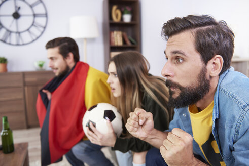 Worried German football fans watching Tv - ABIF00078