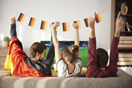 German football fans watching Tv and cheering - ABIF00084