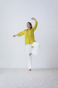 Happy woman doing yoga exercise - MOEF00424