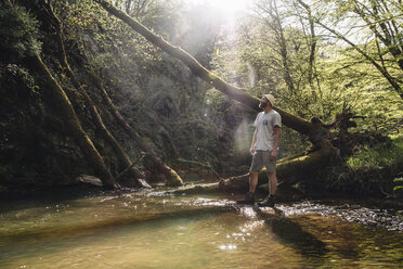 Germany, Rhineland-Palatinate, Vulkan  Eifel, hiker standing at lakeshore - GUSF00266