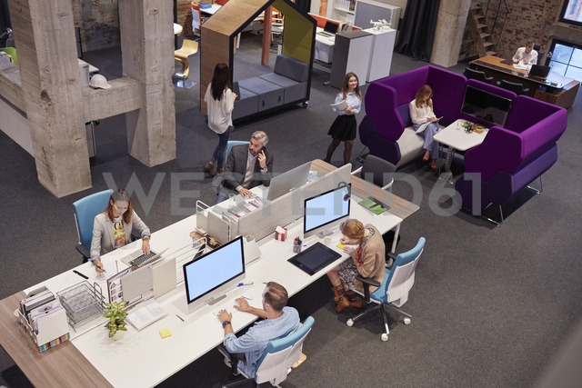 People working in big modern office - WESTF23879