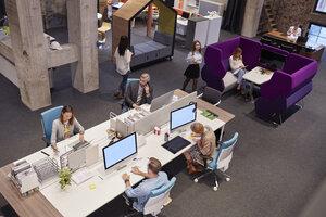 People working in big modern office - WESTF23879