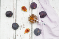 Organic figs and a glass of fig jam on a wood - LVF06526