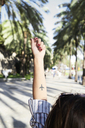 Tattoo of an airplane on forearm of young woman - IGGF00325