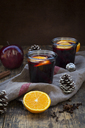 Two glasses of mulled wine with orange slices at Christmas time - LVF06547