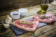 Raw beefsteak with rosemary, salt and pepper - GIOF03691