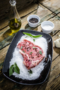 Raw beefsteak with rosemary, salt and pepper - GIOF03694