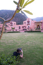 India, Rajasthan, Alwar, female tourist photographing Heritage Hotel Ram Bihari Palace - NDF00718
