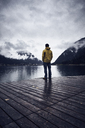 Austria, Tyrol, Lake Achen, man standing on boardwalk - RBF06231