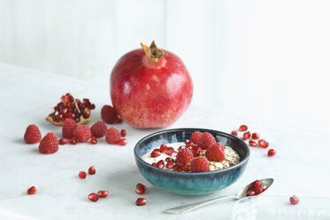 Bowl of fruit muesli with raspberries and pomegranate seed - ASF06137