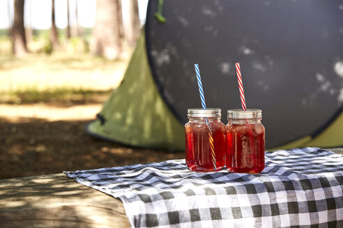 Glasses with juice and drinking straws - SRYF00586