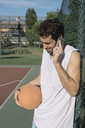 Basketball player on the phone - ALBF00335
