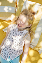 Happy girl lying on a blanket - SRYF00596