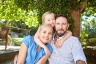 Portrait of happy family in garden - SRYF00635