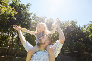 Happy father carrying daughter on shoulders - SRYF00644