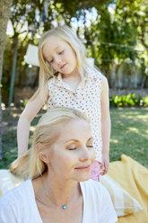 Girl brushing mother's hair - SRYF00662