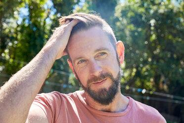 Portrait of bearded man outdoors - SRYF00671