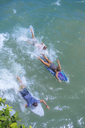 Indonesia, Bali, surfer paddling - KNTF00939
