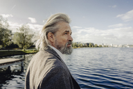 Portrait of serious senior man at a lake - KNSF03330