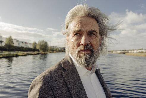 Portrait of serious senior man at a lake - KNSF03333