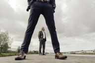 Two businessmen standing on jetty - KNSF03366
