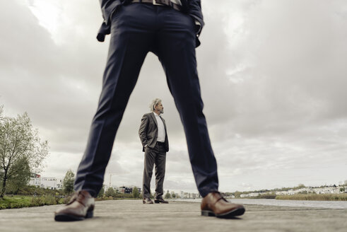 Two businessmen standing on jetty - KNSF03366