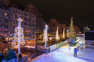 Germany, Cologne, view to Christmas market with ice rink at Heumarkt - WIF03478