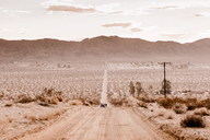 USA, California, Joshua Tree, a street through the desert of Joshua Tree - WVF00859