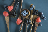 Blueberries, blackberries and raspberries on different spoons - ASF06142