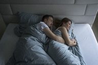 Top view of couple lying in bed at home - MOEF00614