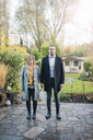 Portrait of smiling couple standing on garden terrace in autumn - MOEF00632