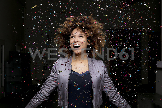 Confetti falling on amazed woman - HHLMF00023