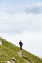 Austria, South Tyrol, hiker on hiking trail - FKF02858