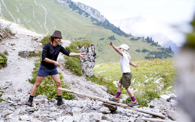 Austria, South Tyrol, girl balancing on wood - FKF02885