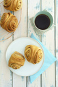 Home-baked Franzbroetchen and cup of coffee - ECF01958